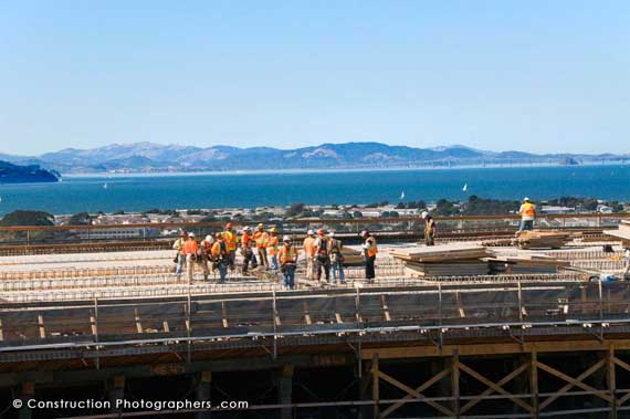 A construction crew is strategizing on the new Oakland Bay Bridge.